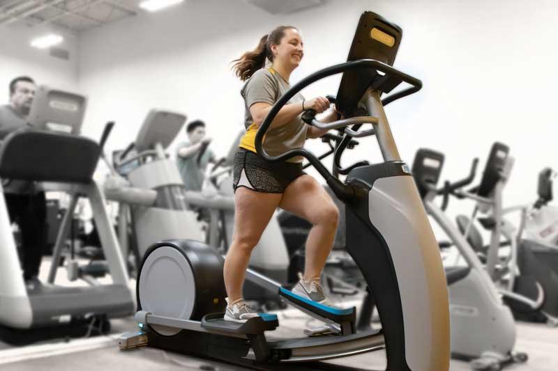 Woman demonstrating elliptical machine