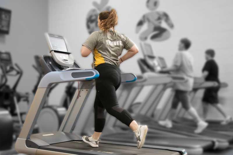 Woman demonstrating treadmill